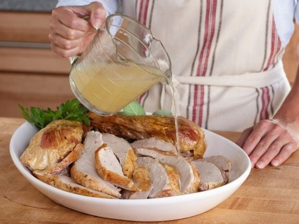 One of the best things you can do while you're cooking the day of Thanksgiving is have a pan of homemade turkey stock or storebought chicken stock on the back burner of your range — you can use it loosen up gravy, moisten sides, or, as foodnetwork.com suggests, revive overcooked turkey.