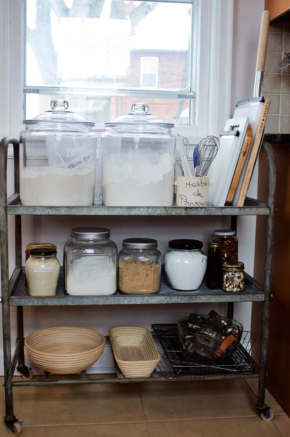 Use one in the kitchen as an open pantry.
