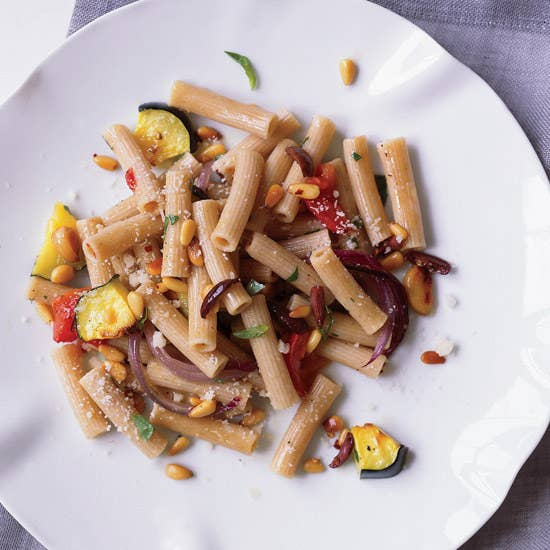 Don't believe anyone who tells you pasta can't be healthy. It can. And those who deny themselves the joy of pasta do not live their greatest lives. First, use whole wheat pasta because like brown rice, it has more nutrients and fiber. Second, add PLENTY of vegetables and some healthy protein. Third, limit your sources of saturated fats like cream, butter, cheese, and fatty meat. Try this Whole Wheat Rigatoni with Roasted Vegetables and Pine Nuts, or this Linguine with Shrimp, Olives, and Sun-Dried Tomatoes. You can also tweak your favorite recipes to be healthier: Try making this fusilli with roasted broccoli and cauliflower with whole wheat noodles, half the pasta and cheese, and twice the veggies.