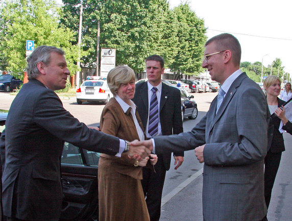 Latvia's Current Foreign Minister Edgars Rinkēvičs greats NATO Secretary General Jaap de Hoop Scheffer and his wife during a 2006 visit.