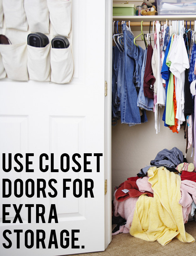 Don't just use your closet doors for opening and closing, use them for extra storage.