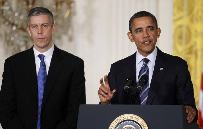 President Barack Obama, accompanied by Education Secretary Arne Duncan.