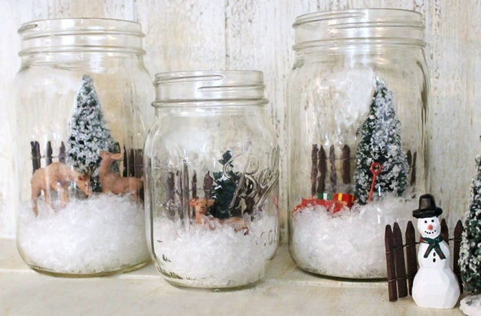 Create pretty wintery Mason jar scenes with small toys and cotton batting.