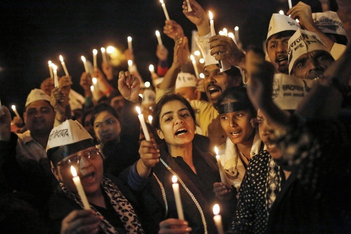 People participate in a candlelight vigil in protest of the rape of a female Uber passenger on Dec. 8.