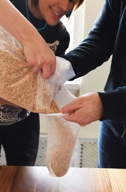 Putting grain in a steeping bag