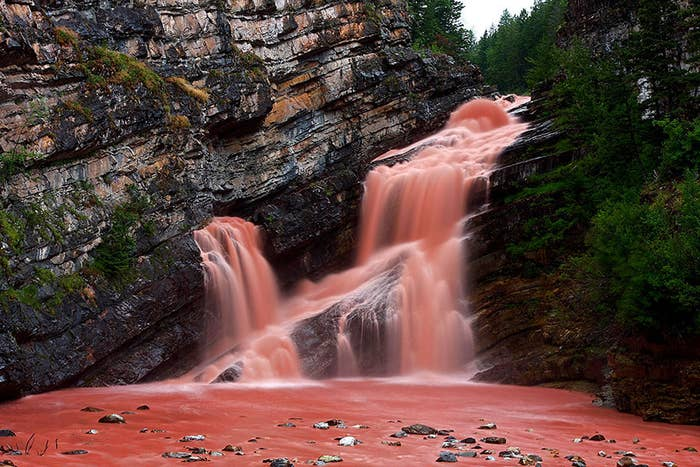 This might look like a scene straight out of the Bible, but it's actually a natural phenomenon where large amounts of red-colored sediment called argolite washed down the waterfall due to heavy rainfall.