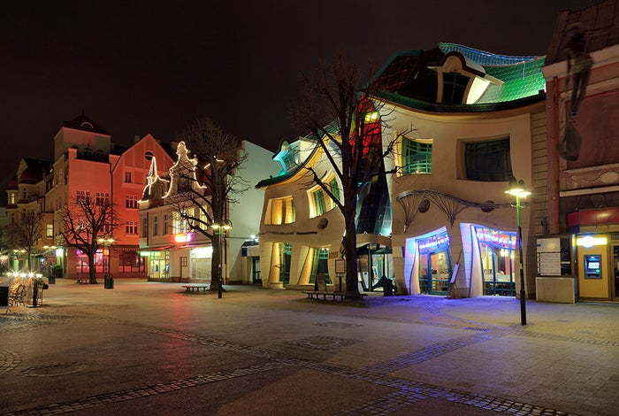 """Nope, this isn't a bad photoshop job. Krzywy Domek, Polish for """"crooked house,"""" was actually built this way."""