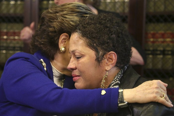 Attorney Gloria Allred hugs Chelan at a press conference on Wednesday, Dec. 3.