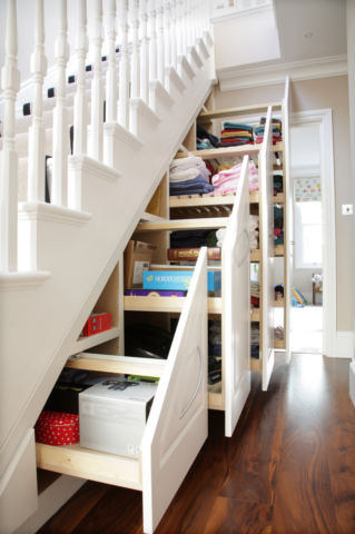 3. Too many towels? Build slide out drawers for extra storage. & 27 Genius Ways To Use The Space Under Your Stairs