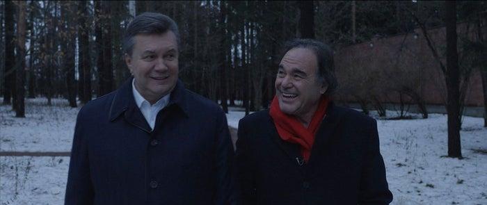 Former Ukrainian president Viktor Yanukovych, right, and director Oliver Stone