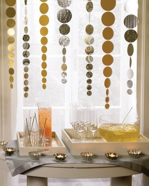 A hole punch and some string + your leftover wrapping paper = beautiful party decorations for NYE, your next bash, or just because. Follow this tutorial, and make sure to measure the distance between the ceiling and punch bowl to avoid any potential disasters.