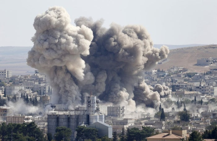 Smoke rises after a U.S.-led air strike in the Syrian town of Kobani.