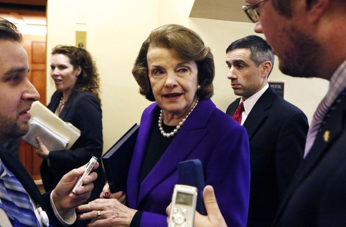U.S. Senator Dianne Feinstein talks to reporters as she walks to the Senate floor on Tuesday.