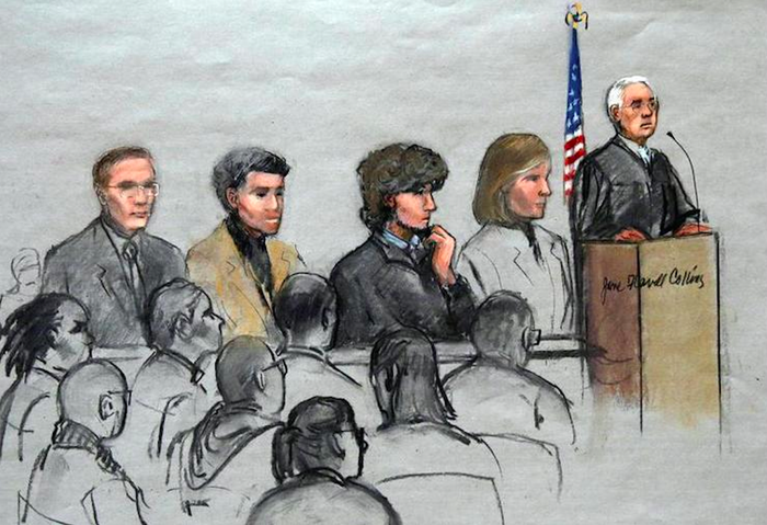 In this courtroom sketch, Dzhokhar Tsarnaev is depicted with his lawyers and U.S. District Judge George O'Toole Jr. at jury selection for the Boston bombing trial.