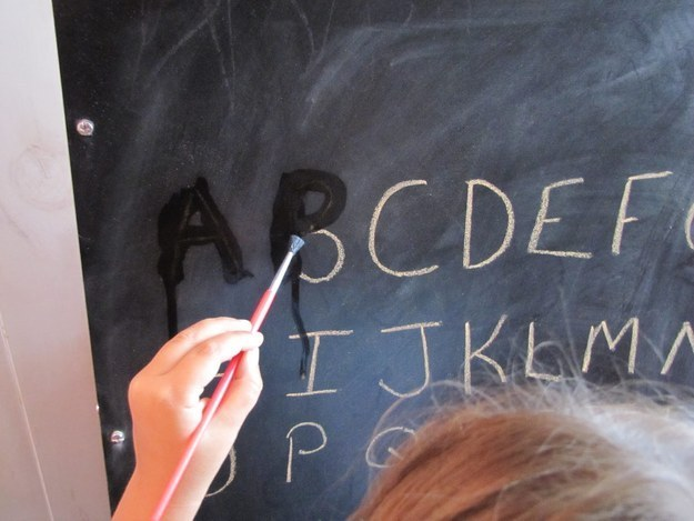 Create an easy tracing activity with a chalkboard and paintbrush.