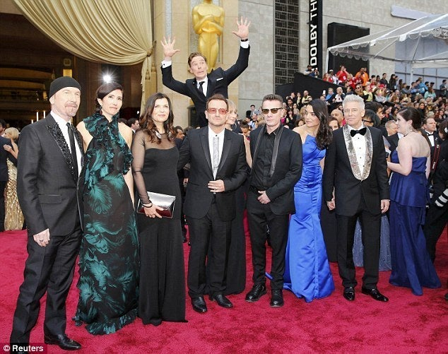 Here he is eagerly jumping into a photo with U2 at the 2014 Oscars.