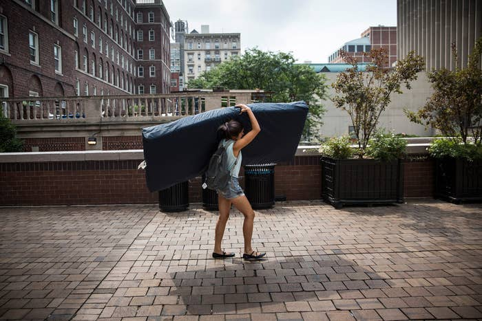 A photo of the Columbia senior Emma Sulkowicz who vows to carry a mattress around campus until the man who allegedly raped her leaves the school.