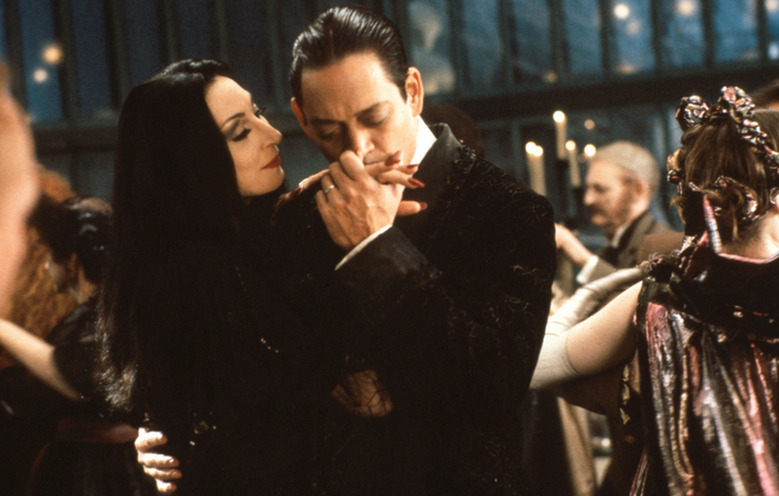 """They're creepy, they're kooky...and they're perfect for each other. You'd be hard-pressed to find a more passionate couple than Gomez and Morticia Addams. In the words of Gomez, """"I would die for her. I would kill for her. Either way, what bliss."""""""