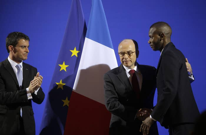 Bathily has lived in France since 2006 and filed his application for citizenship last year, the Associated Press reported. French Interior Minister Bernard Cazeneuve (pictured above center) shook Bathily's hand and praised his courage and heroism as Prime Minister Manuel Valls applauded.