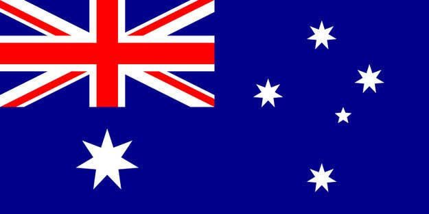 It features a blue field with the Union Jack top left, and a large white seven-pointed star known as the Commonwealth Star, with the Southern Cross.