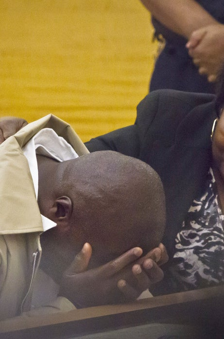 David McCallum weeps after his exoneration in October 2014 in New York. He was 16 when he was convicted of murder.