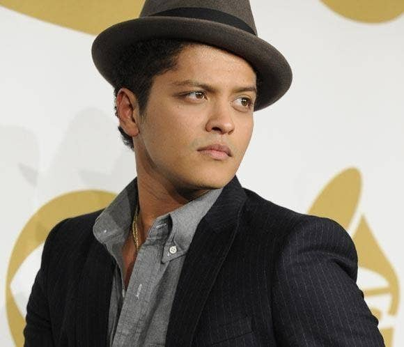 "And he's STILL on the top of the charts, helping out on Mark Ronson's ""Uptown Funk."""