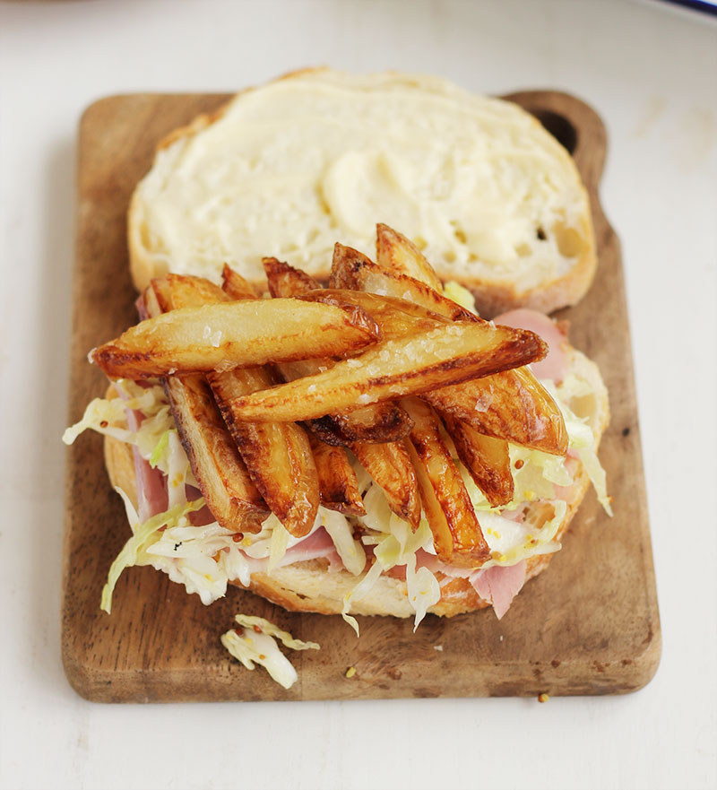 There's ham! There's slaw! There are got dang FRENCH FRIES! This sandwich is here to save your life. Get the recipe.