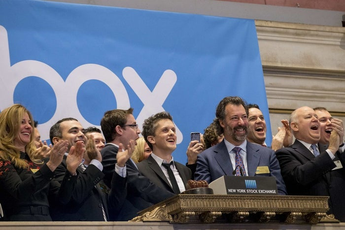 Online data storage provider Box Inc Co-Founder and CEO Aaron Levie (C) rings the opening bell to celebrate his company's IPO at the New York Stock Exchange January 23, 2015.