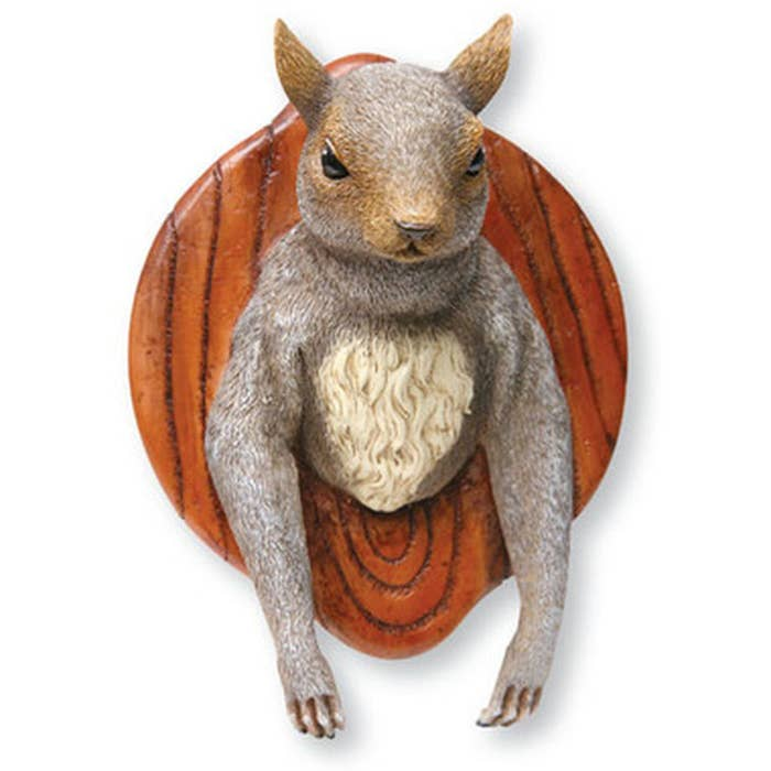 Since when do squirrels look that malicious? And why does it look like he has human arms and fingers?! What kind of beast is this even?