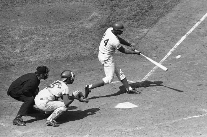 Ernie Banks connects with the ball for his 2,500th base hit of his major league career on Sept. 19, 1969, in Chicago.