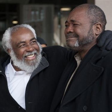 Wiley Bridgeman, 60, of Cleveland, left, is all smiles as his brother Ronnie, who is now known as Kwame Ajamu chokes up as they walk from the Cuyahoga County Justice Center after Bridgeman's release from a life sentence for a 1975 murder on Nov. 21, 2014 in Cleveland.