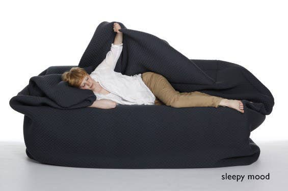 34 nap worthy chairs youll dream about this afternoon swaddle yourself in this couch blanket all in one solutioingenieria Image collections