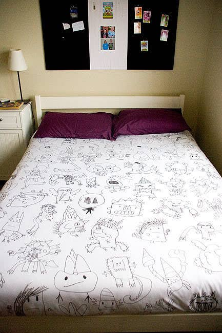 This is painstaking, but genius and worth it. Jen over at Jen Thousand Words copied, de-colored, and then traced her son's artwork on this one of a kind duvet.For more inspiration, check out Fun at Home with Kids' quilted version.