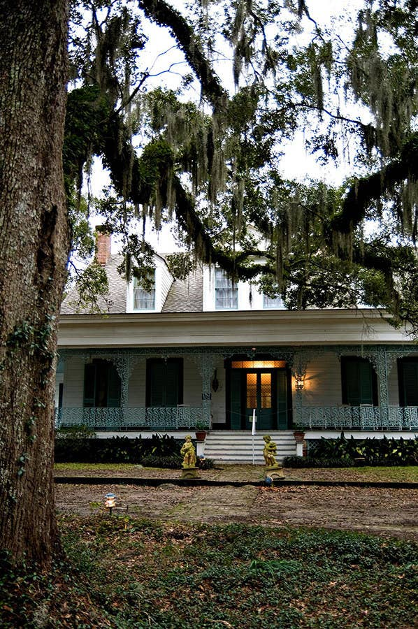"""An aura of mystery and terror surrounds Myrtles Plantation, """"one of America's most haunted homes"""" built on an Indian burial ground, and where up to ten people might have been murdered and which supposedly plays home to at least a dozen unsettled spirits.Legend has it that the hauntings began because of Chloe, who was a slave owned by Clark and Sara Woodruff, the original owners. Purportedly, Clark wanted Chloe to be his mistress, she refused, and he continued to pressure her and may have forced her into having sex with him. Then, after she was caught eavesdropping on Sara, one of them chopped off her ear and she wore a green turban to disguise it. She baked a poisonous birthday cake in retaliation, but the plan backfired and Sara and their two daughters died from poisoning, while Clark survived. Ever since, guests at the bed and breakfast have reported sightings of a woman wearing a green turban stalking the grounds.Unfortunately, that's not all. The house was reportedly once ransacked by Union soldiers during the Civil War, and three were killed inside. A disgruntled, young Indian girl has been spotted on the plantation, and there's supposedly a blood stain in the shape of a human body that cannot be removed or even touched by mops or cleaning supplies. There is so much legend to this property that revisiting it seems completely necessary."""