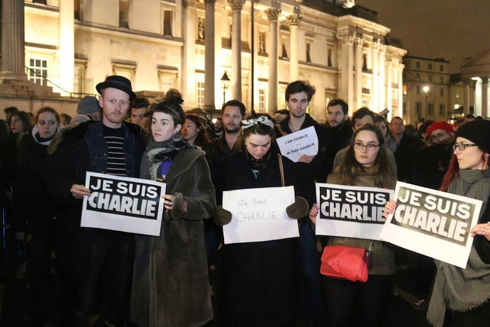 """The gathering, organised on Facebook just two hours earlier, was in response to the murder of 12 journalists at the French satirical newspaper Charlie Hebdo. It was held at the same time as large vigils in other cities around Europe.From 6pm onwards hundreds of individuals arrived at London's main square, mainly holding the alreadyubiquitous """"Je Suis Charlie"""" signs –some were printed out, while others were scrawled on cardboard or displayed on iPad screens."""