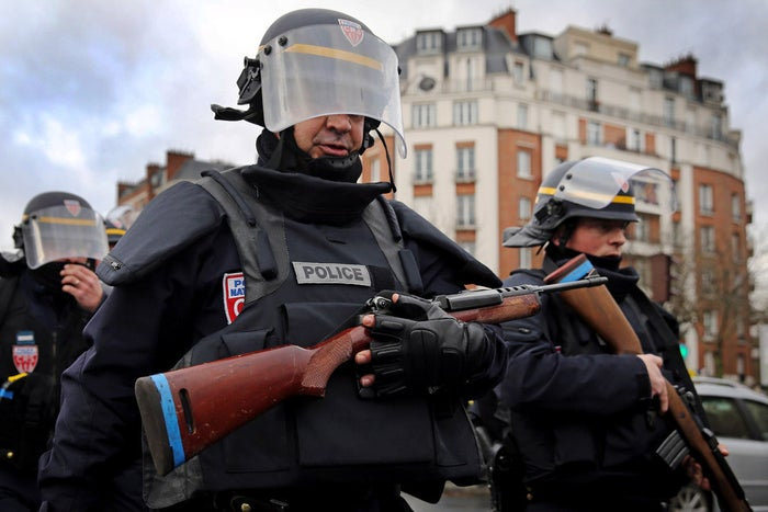 An explosion lights the front of a kosher supermarket east of Paris as French police launched an assault on the hostage taker.