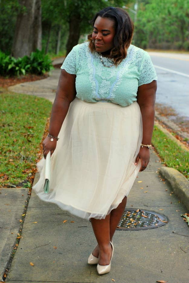 If you have a beautiful top with detail on the shoulder, pair it like this blogger with a flowy skirt that balances out your shoulders and lower body.