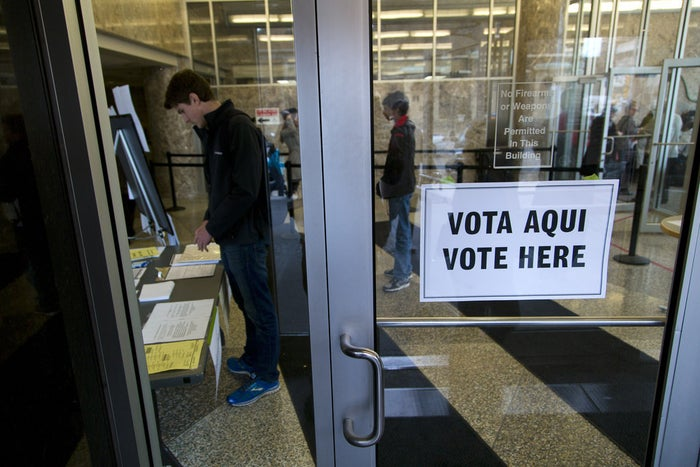 MILWAUKEE, WI - NOVEMBER 4: A man checks in at the city hall building where citizens cast their vote on election day November 4, 2014 in Milwaukee, Wisconsin.