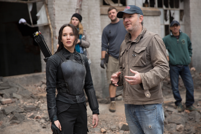 """""""In the beginning of this adaptation, you'll see that we made a jump from the book. The book opens with Katniss walking through the ruins of District 12, and we kind of only hear in her thoughts the backstory of her time in District 13. Pretty quickly we knew that wasn't going to work and we were going to have to see Katniss getting acclimated to District 13 and meeting President Coin for the first time as opposed to jumping in the middle of the action."""" —Francis Lawrence, director""""Coming off of Catching Fire we hadthe question of, where do want this story to begin? And we made the choice to have it begin one or two weeks after she had been lifted out of the arena."""" —Nina Jacobson, producer"""