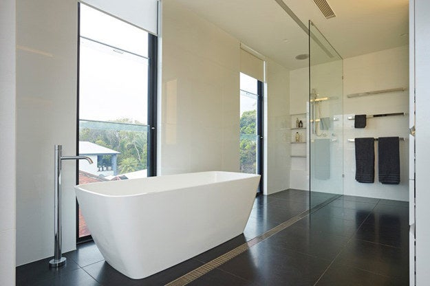 Combining monochromatic styling with a minimal take on peripheral design can really allow you to take full advantage of a room. This has been utilised here to create this modern wet room.