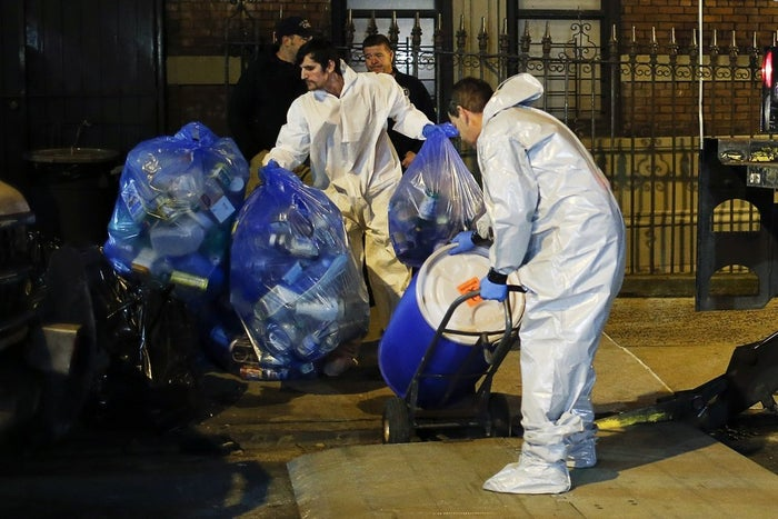 Workers from Bio-Recovery's cleaning crew outside of the apartment where Dr. Craig Spencer lives in New York City.