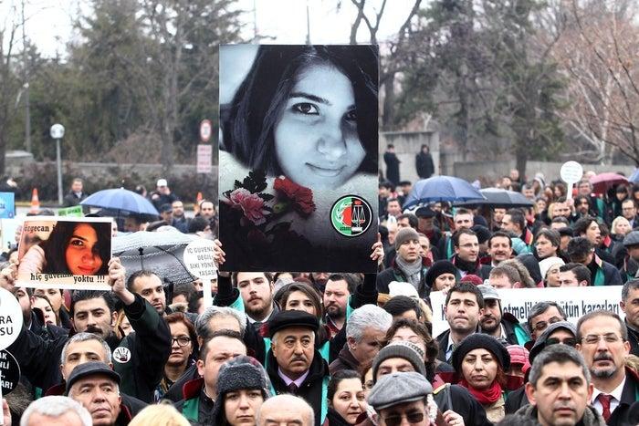 A member of Turkey's bar association holds a poster depicting the slain Özgecan Aslan in Ankara, Feb. 16, 2015.