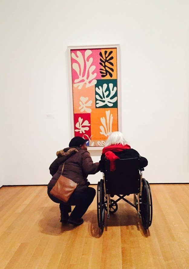 """As I watched the young woman bend down to the elderly woman's wheelchair, I contemplated approaching them and asking their story-Why were they here? How did they know each other? What did this Exhibit mean to them? But then, as I attempted to answer each of these questions myself, I realized that this was the hope that Matisse wanted each of us to see. He was provoking us to ask questions and draw our own conclusions on his """"paintings with scissors"""". What were these shapes? Why the colors? How did he decide on the placement? These were all questions that had answers, but answers that only had meaning to me. I decided not to approach the duo, as I had already written a beautiful story for the two of them in my own mind, a story that only I will know, but a story I will never forget."""