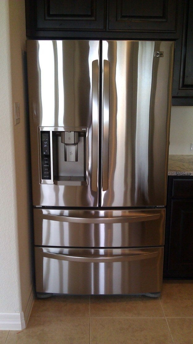 See how shiny this fridge looks? PROBS BC OF WOOD FURNITURE POLISH. Don't use on your floor, tho, unless you're trying to prank someone.