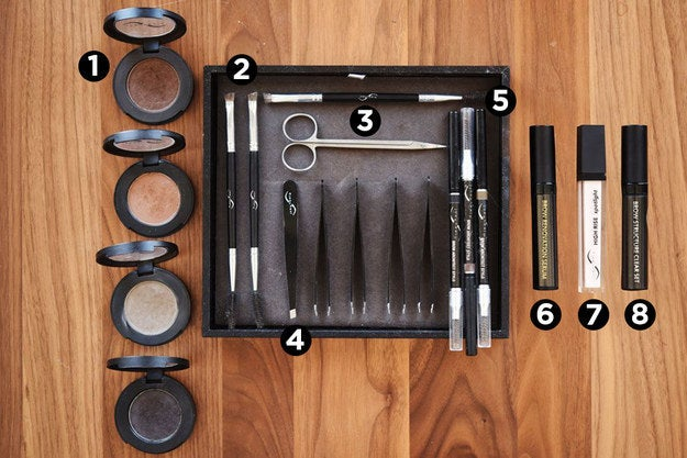 1. Eyebrow Powder, for filling in thin or patchy spots. 2. Eyebrow Brush (with one angled powder brush and one spoolie brush), for applying powder and combing through hairs.3. Eyebrow Scissors, for trimming long hairs4. Tweezer, for tweezing stray hairs.5. Eyebrow pencils (with a spoolie brush on the end), for correcting the shape of your brows and then filling them in. 6. Eyebrow serum, for growth. 7. Eyebrow highlighter, for underneath the arch of your eyebrow. 8. Clear eyebrow gel, for keeping your eyebrow hairs in place once you've groomed them. Not pictured: Eyebrow razor, or a dermaplaning tool, used for getting rid of extra hair on the face around the eyebrows.