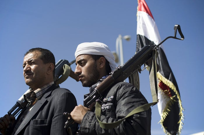 Houthi Shiite Yemenis hold their weapons during a rally to show support for their comrades in Sanaa.