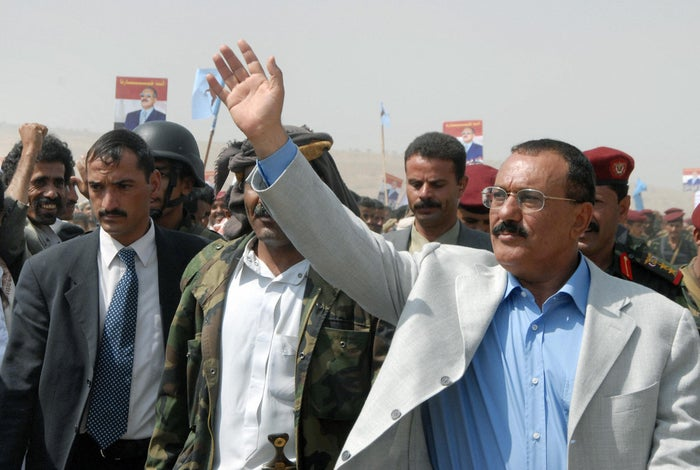 Then-Yemeni President Ali Abdullah Salih waves to supporters as he kicks off his presidential election campaign in 2006
