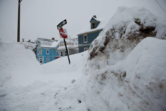Greg Burkett clears snow from the front of his house in Cambridge, Massachusetts on February 9.