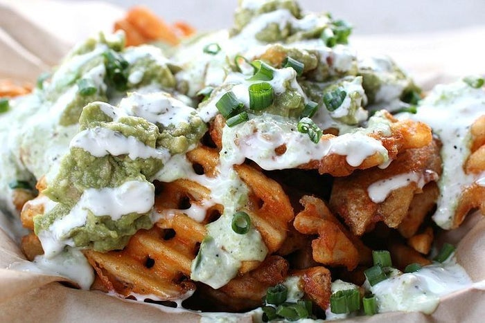 This popular L.A. food truck is responsible for the greatest marriage of our time: waffle fries and nachos. Try the Green Dragon wachoes, which comes with an eponymous sauce, guacamole, scallions and ranch (pictured), or the Buffalo wachos, which come tossed in diablo or angel sauce with bleu cheese, bacon, scallions and ranch.Suggested by ypuentes.