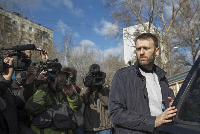 Russian opposition activist Alexey Navalny gets in a car as he leaves a detention center in Moscow.